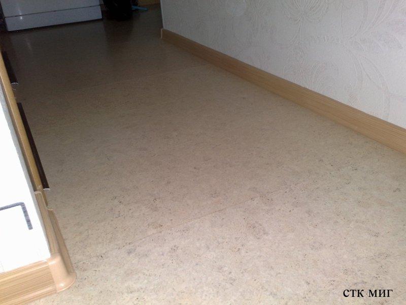 Укладка ламината в гостинной.Фото